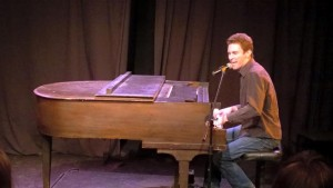 Playing at Drop The Mic, a show at MCL. (source)